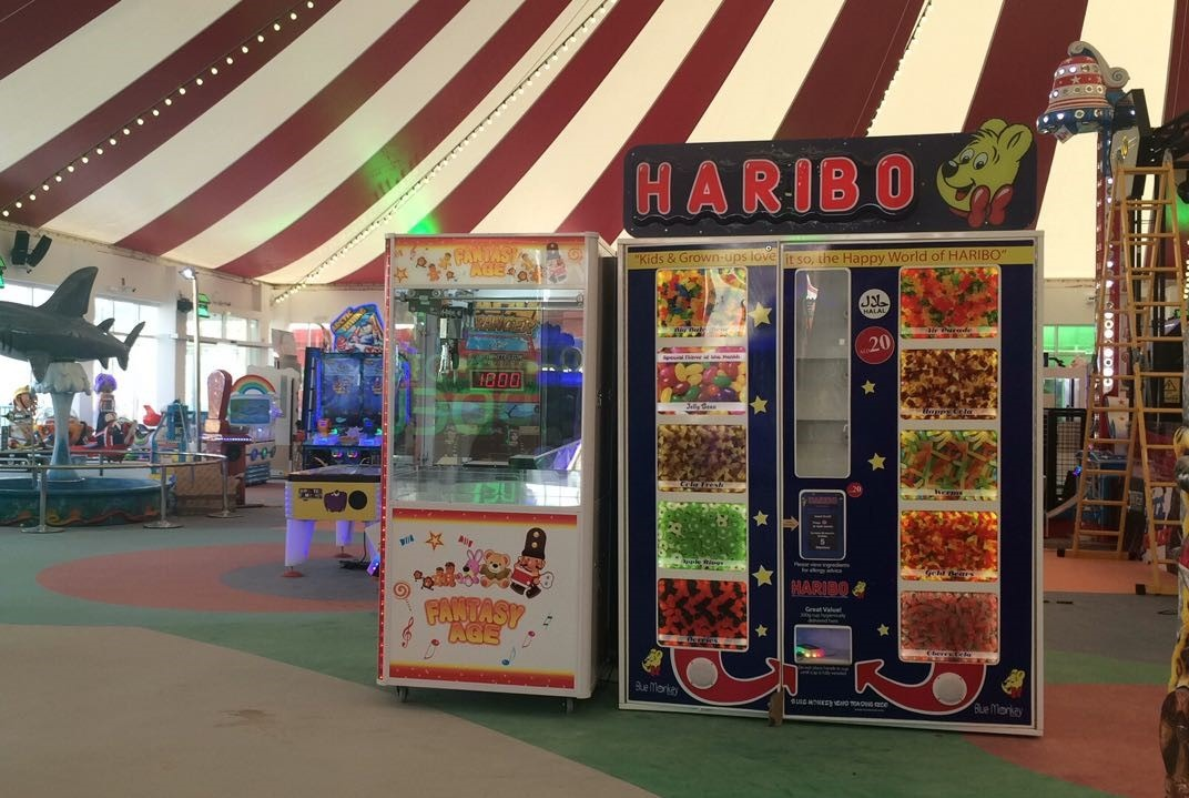 Blue Monkey Vending Haribo at Global Village Dubai.